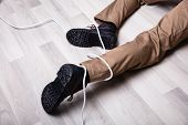 Low Section Of Male Electrician Wrapped In Wire Fallen On Floor poster