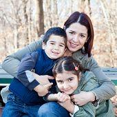 Happy Mother Hugging Her Children