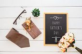 Happy Fathers Day Concept. Flat Lay Image Of Gift Box, Necktie, Glasses, Rose Flower And Notebook W poster