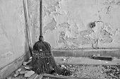 Straw Broom On Dirty Floor