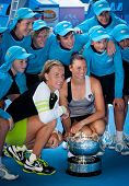 MELBOURNE - JANUARY 27: Svetlana Kuznetsova (L) and Vera Zvonareva of Russia with the doubles championship trophy at the 2012 Australian Open on January 27, 2012 in Melbourne, Australia.
