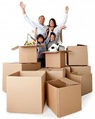 Family excited about moving with arms up and cardboard boxes
