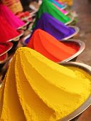 pic of haldi  - Colorful piles of powdered dyes used for holi festival on display in an indian shop at mysore - JPG