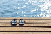 Pair Of Flip Flops On The Wooden Dock And Scenery Of Lake River At Natural Background. poster