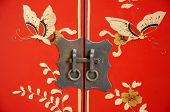 Beautiful decor lock on the door of old Chinese furniture.