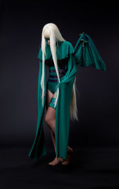 picture of banshee  - blond girl posing in green fury cosplay costume anime character - JPG