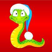 Green snake in red Santa's hat