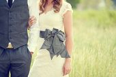 lace bridal couture dress with a grey bow