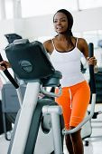 foto of gym workout  - beautiful woman at the gym exercising in the cardio machines - JPG