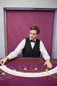 Dealer spreading the deck in casino