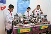 SUBANG JAYA - NOVEMBER 10:Unidentified students from Thailand demonstrates how robots dispense pills
