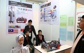 SUBANG JAYA - NOV 10: Unidentified Malaysian students shows their robot nurse who can communicate an