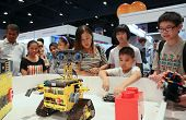 SUBANG JAYA - NOVEMBER 10: Robots perform for unidentified visitors at the World Robot Olympaid on N