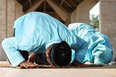 Muslim Family Praying