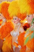 MOSCOW - DECEMBER 15: Beautiful women in orange fake fur of famous Parisian cabaret Moulin Rouge in