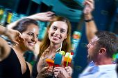 picture of party people  - Motioned portrait of young attractive people having fun in night club - JPG
