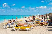 VARADERO,CUBA-NOVEMBER 4:Tourists sunbathing at the beach November 4,2012 in Varadero.With 9% more v