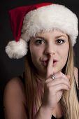Pretty Girl With Santa Hat Saying Shhhhh