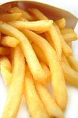 A close up of golden brown fried french fries