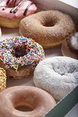 Variety of doughnuts in box