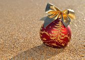 Christmas Decoration On A Beach Sand