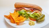 Italian Sub Sandwich With Pickle And Tortilla Chips