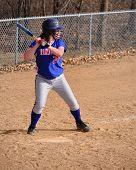 picture of fastpitch  - A Teen Girl Softball Player Batting vertical - JPG