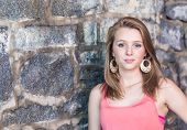 Teenage Girl with Old Wall In Background