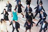 Overhead View Of Businesspeople Dancing In Office Lobby