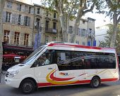 Aix en Bus minibus in medieval part of Aix en Provence, France