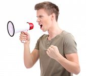 Portrait of young man handsome shouting using megaphone , isolated on white