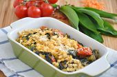 Gratin with spinach, red lentils and wild garlic