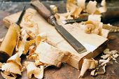 Old Wood Chisels With Shavings On The Workbench