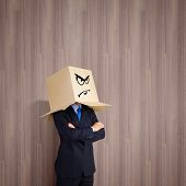 Businessman with box on head showing different emotions
