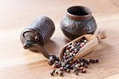 Peppercorns On Wooden Table
