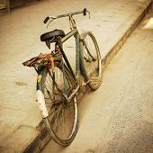 Old bicycle in the street, retro look