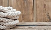 ship ropes on wood background