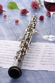 stock photo of aerophone  - Oboe with notes and summer feeling Studio Shot - JPG
