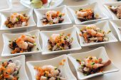 image of banquet  - Individual seafood starters or appetizers with fresh prawns or shrimp displayed on a buffet table at a banquet or catered event - JPG