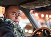 DAHAB, EGYPT - JANUARY 1, 2011: Portrait of the taxi driver. Taxi is favourite transport for western