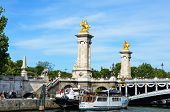 Houseboats moored beside Pont Alexandre III