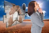 Smiling thoughtful businesswoman against 3d plane taking off over cornfield
