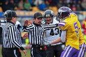 VIENNA,  AUSTRIA - MARCH 24 WR Laurinho Walch (#5 Vikings) has discussion with referee Bojan Savicev
