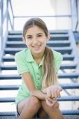 pic of tween  - Portrait of Smiling Tween Girl Sitting On Stairway - JPG