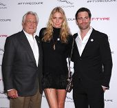 LOS ANGELES - NOV 19:  George Lazenby, Jodie Kidd and David Blakeley arrives to the Jaguar F-TYPE Global Reveal Event  on November 19, 2013 in Playa Vista, CA