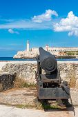 Old cannon aiming at the famous fortress of El Morro in Old Havana