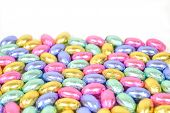 image of easter candy  - group of colorful easter egg candy on white - JPG