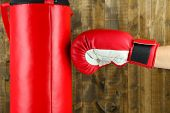 Box training and punching bag, on wooden background