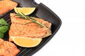 pic of frizzle  - Salmon in pan with lemon and rosemary - JPG