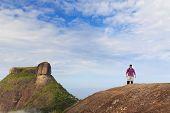 Man On Edge Of Mountain Pedra Bonita, Rio De Janeiro, Brazil